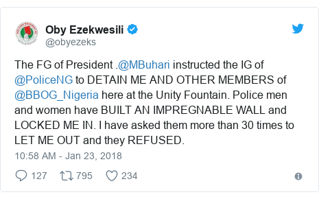 Twitter post by @obyezeks: The FG of President .@MBuhari instructed the IG of @PoliceNG to DETAIN ME AND OTHER MEMBERS of @BBOG_Nigeria here at the Unity Fountain. Police men and women have BUILT AN IMPREGNABLE WALL and LOCKED ME IN. I have asked them more than 30 times to LET ME OUT and they REFUSED.