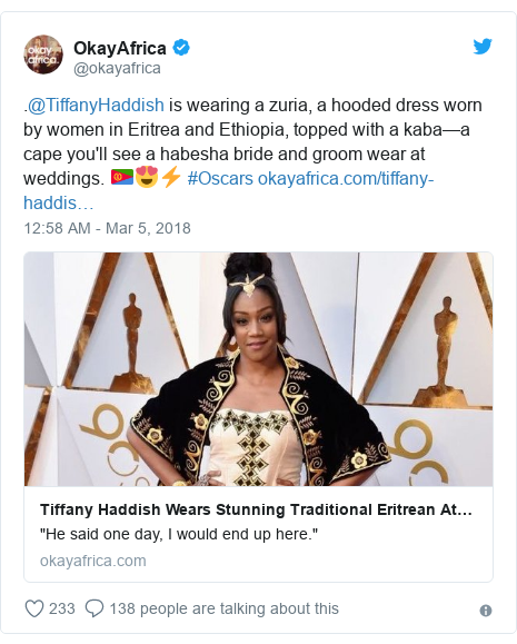 Twitter post by @okayafrica: .@TiffanyHaddish is wearing a zuria, a hooded dress worn by women in Eritrea and Ethiopia, topped with a kaba—a cape you'll see a habesha bride and groom wear at weddings. 🇪🇷😍⚡️ #Oscars