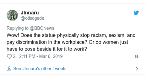 Twitter post by @otisogede: Wow! Does the statue physically stop racism, sexism, and pay discrimination in the workplace? Or do women just have to pose beside it for it to work?