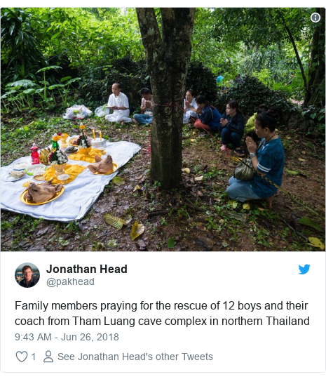 Twitter post by @pakhead: Family members praying for the rescue of 12 boys and their coach from Tham Luang cave complex in northern Thailand