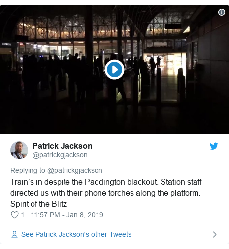 Twitter post by @patrickgjackson: Train's in despite the Paddington blackout. Station staff directed us with their phone torches along the platform. Spirit of the Blitz