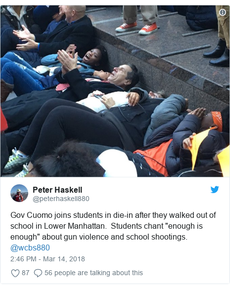 """Twitter post by @peterhaskell880: Gov Cuomo joins students in die-in after they walked out of school in Lower Manhattan.  Students chant """"enough is enough"""" about gun violence and school shootings.  @wcbs880"""