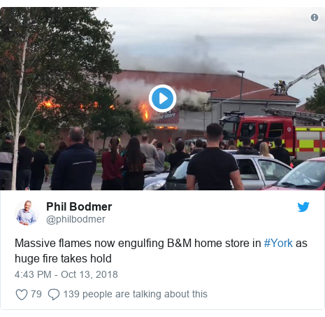 Twitter post by @philbodmer: Massive flames now engulfing B&M home store in #York as huge fire takes hold
