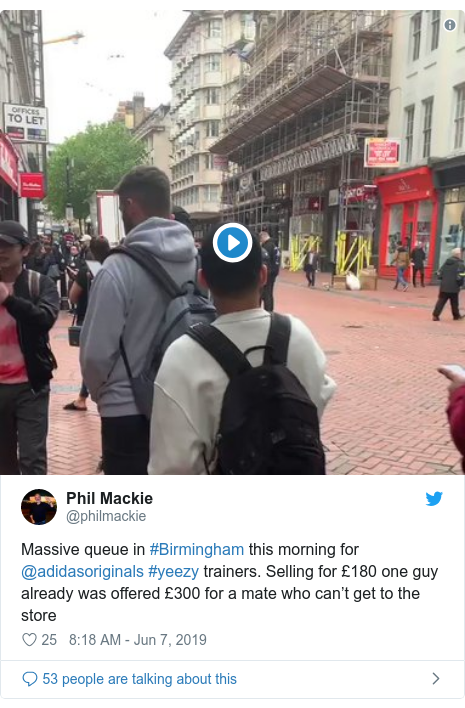 Twitter post by @philmackie: Massive queue in #Birmingham this morning for @adidasoriginals #yeezy trainers. Selling for £180 one guy already was offered £300 for a mate who can't get to the store