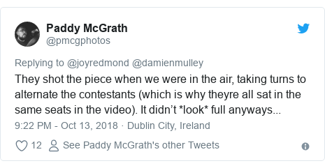 Twitter post by @pmcgphotos: They shot the piece when we were in the air, taking turns to alternate the contestants (which is why theyre all sat in the same seats in the video). It didn't *look* full anyways...
