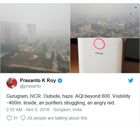 Twitter post by @prasanto: Gurugram, NCR. Outside, haze. AQI beyond 600. Visibility ~400m. Inside, air purifiers struggling, an angry red.