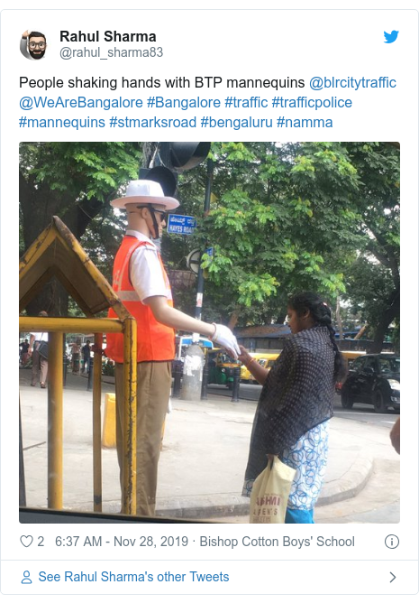 Twitter post by @rahul_sharma83: People shaking hands with BTP mannequins @blrcitytraffic @WeAreBangalore #Bangalore #traffic #trafficpolice #mannequins #stmarksroad #bengaluru #namma