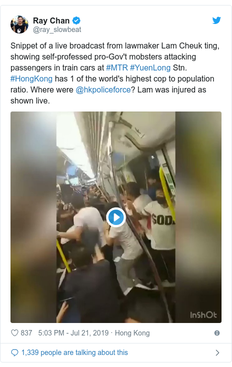 Twitter post by @ray_slowbeat: Snippet of a live broadcast from lawmaker Lam Cheuk ting, showing self-professed pro-Gov't mobsters attacking passengers in train cars at #MTR #YuenLong Stn. #HongKong has 1 of the world's highest cop to population ratio. Where were @hkpoliceforce? Lam was injured as shown live.