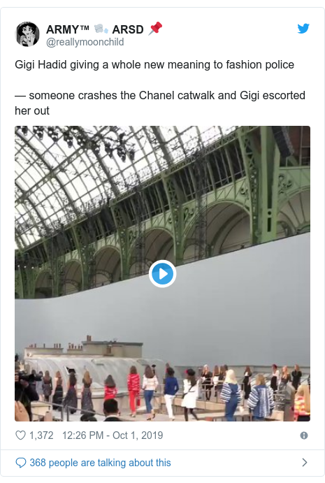 Twitter post by @reallymoonchild: Gigi Hadid giving a whole new meaning to fashion police — someone crashes the Chanel catwalk and Gigi escorted her out