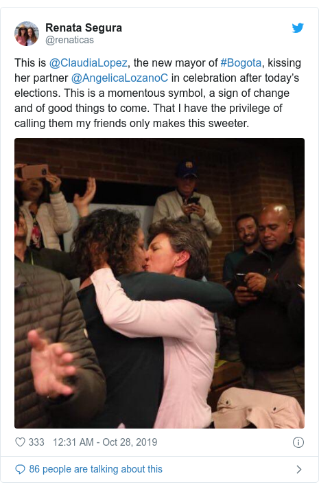 Twitter post by @renaticas: This is @ClaudiaLopez, the new mayor of #Bogota, kissing her partner @AngelicaLozanoC in celebration after today's elections. This is a momentous symbol, a sign of change and of good things to come. That I have the privilege of calling them my friends only makes this sweeter.