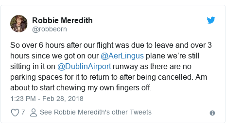 Twitter post by @robbeorn: So over 6 hours after our flight was due to leave and over 3 hours since we got on our @AerLingus plane we're still sitting in it on @DublinAirport runway as there are no parking spaces for it to return to after being cancelled. Am about to start chewing my own fingers off.