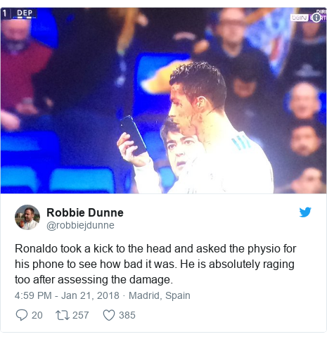 Twitter post by @robbiejdunne: Ronaldo took a kick to the head and asked the physio for his phone to see how bad it was. He is absolutely raging too after assessing the damage.