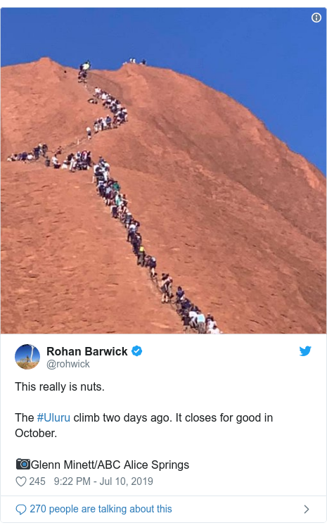 Twitter post by @rohwick: This really is nuts.The #Uluru climb two days ago. It closes for good in October.📷Glenn Minett/ABC Alice Springs