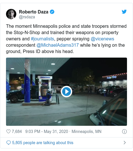 Twitter post by @rsdaza: The moment Minneapolis police and state troopers stormed the Stop-N-Shop and trained their weapons on property owners and #journalists, pepper spraying @vicenews correspondent @MichaelAdams317 while he's lying on the ground, Press ID above his head.