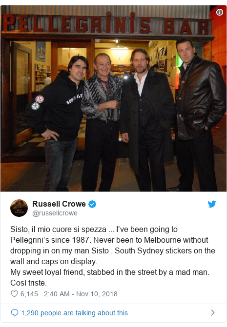 Twitter post by @russellcrowe: Sisto, il mio cuore si spezza ... I've been going to Pellegrini's since 1987. Never been to Melbourne without dropping in on my man Sisto . South Sydney stickers on the wall and caps on display.My sweet loyal friend, stabbed in the street by a mad man.Cosí triste.