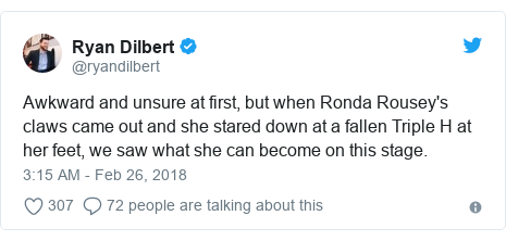 Twitter post by @ryandilbert: Awkward and unsure at first, but when Ronda Rousey's claws came out and she stared down at a fallen Triple H at her feet, we saw what she can become on this stage.