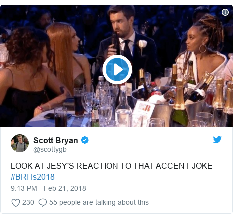 Twitter post by @scottygb: LOOK AT JESY'S REACTION TO THAT ACCENT JOKE #BRITs2018