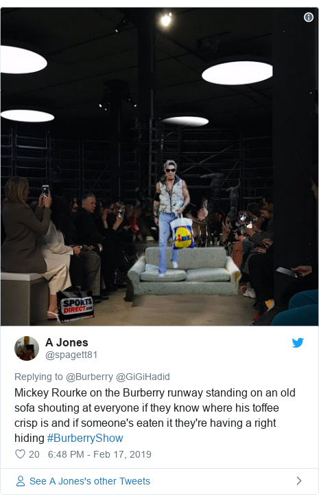Twitter post by @spagett81: Mickey Rourke on the Burberry runway standing on an old sofa shouting at everyone if they know where his toffee crisp is and if someone's eaten it they're having a right hiding #BurberryShow