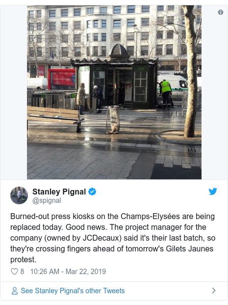 Twitter post by @spignal: Burned-out press kiosks on the Champs-Elysées are being replaced today. Good news. The project manager for the company (owned by JCDecaux) said it's their last batch, so they're crossing fingers ahead of tomorrow's Gilets Jaunes protest.