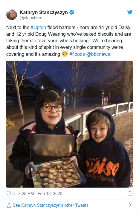 Twitter post by @stanchers: Next to the #Upton flood barriers - here are 14 yr old Daisy and 12 yr old Doug Wearing who've baked biscuits and are taking them to 'everyone who's helping'. We're hearing about this kind of spirit in every single community we're covering and it's amazing 😊 #floods @bbcnews