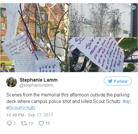 Twitter post by @stephanierlamm: Scenes from the memorial this afternoon outside the parking deck where campus police shot and killed Scout Schultz. #ajc #ScoutSchultz pic.twitter.com/n6g2VOmnc4