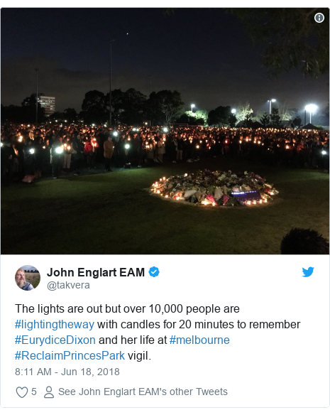 Twitter post by @takvera: The lights are out but over 10,000 people are #lightingtheway with candles for 20 minutes to remember #EurydiceDixon and her life at #melbourne #ReclaimPrincesPark vigil.