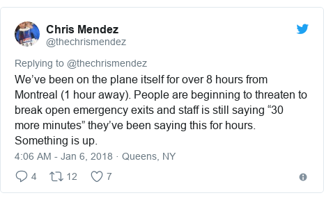 """Twitter post by @thechrismendez: We've been on the plane itself for over 8 hours from Montreal (1 hour away). People are beginning to threaten to break open emergency exits and staff is still saying """"30 more minutes"""" they've been saying this for hours. Something is up."""