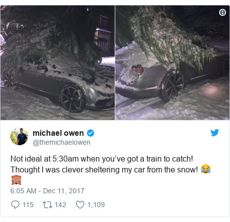 Twitter post by @themichaelowen: Not ideal at 5 30am when you've got a train to catch! Thought I was clever sheltering my car from the snow! 😂🙈