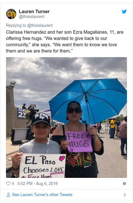 "Twitter post by @thisislaurent: Clarissa Hernandez and her son Ezra Magallanes, 11, are offering free hugs. ""We wanted to give back to our community,"" she says. ""We want them to know we love them and we are there for them."""