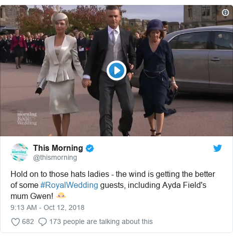 Twitter post by @thismorning: Hold on to those hats ladies - the wind is getting the better of some #RoyalWedding guests, including Ayda Field's mum Gwen! 👒