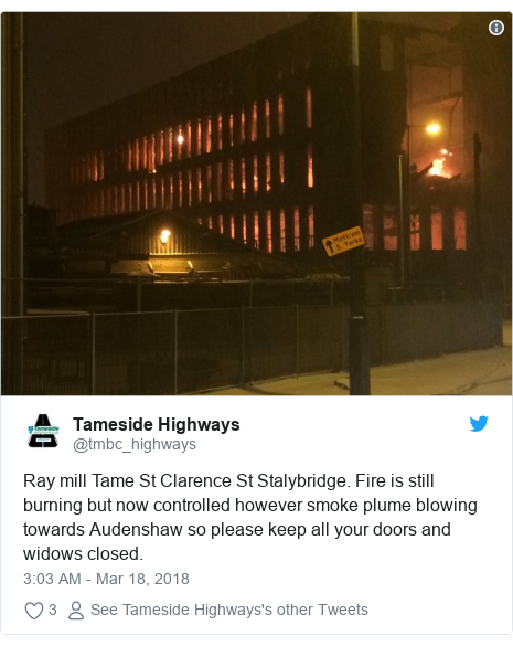 Twitter post by @tmbc_highways: Ray mill Tame St Clarence St Stalybridge. Fire is still burning but now controlled however smoke plume blowing towards Audenshaw so please keep all your doors and widows closed.