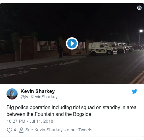 Twitter post by @tv_KevinSharkey: Big police operation including riot squad on standby in area between the Fountain and the Bogside