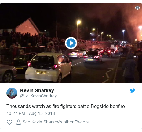 Twitter post by @tv_KevinSharkey: Thousands watch as fire fighters battle Bogside bonfire