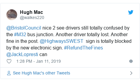 Twitter post by @walkes220: @BristolCouncil nice 2 see drivers still totally confused by the #M32 bus junction. Another driver totally lost. Another fine in the post. @HighwaysSWEST  sign is totally blocked by the new electronic sign. #RefundTheFines @JackLopresti can