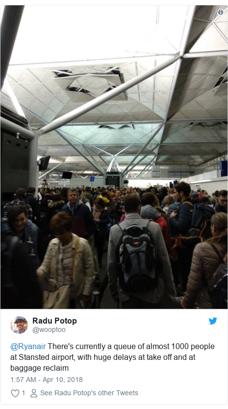 Twitter post by @wooptoo: @Ryanair There's currently a queue of almost 1000 people at Stansted airport, with huge delays at take off and at baggage reclaim