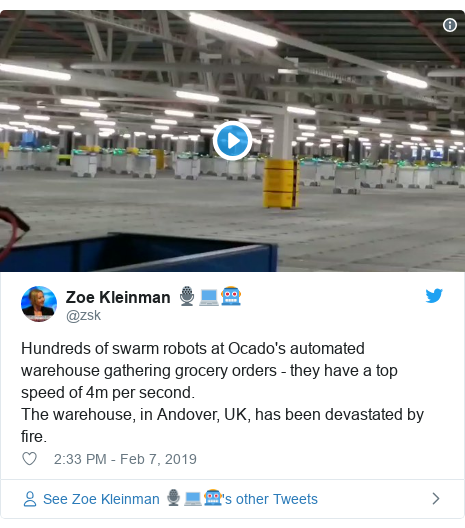 Twitter post by @zsk: Hundreds of swarm robots at Ocado's automated warehouse gathering grocery orders - they have a top speed of 4m per second. The warehouse, in Andover, UK, has been devastated by fire.
