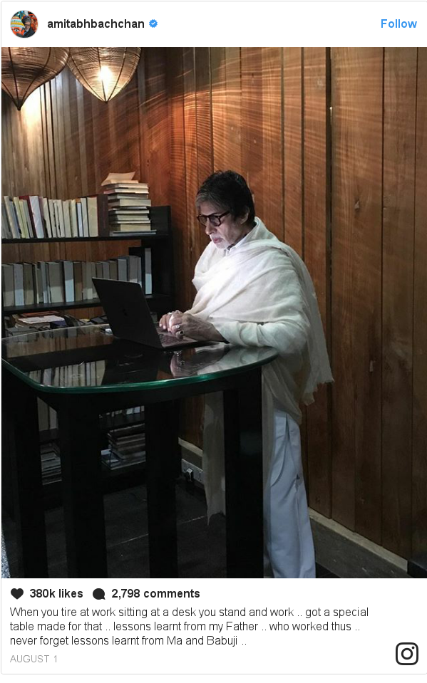 Instagram post by amitabhbachchan: When you tire at work sitting at a desk you stand and work .. got a special table made for that .. lessons learnt from my Father .. who worked thus .. never forget lessons learnt from Ma and Babuji ..