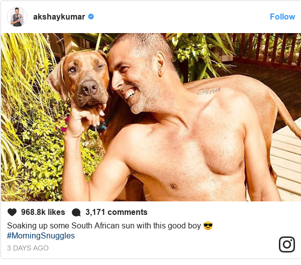 Instagram post by akshaykumar: Soaking up some South African sun with this good boy 😎 #MorningSnuggles