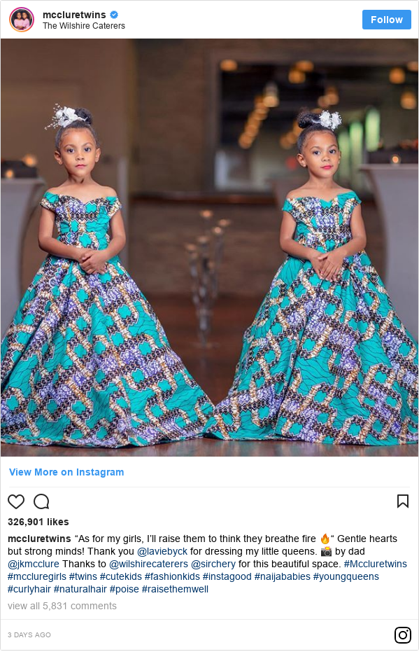 "Ujumbe wa Instagram wa mccluretwins: ""As for my girls, I'll raise them to think they breathe fire 🔥"" Gentle hearts but strong minds! Thank you @laviebyck for dressing my little queens. 📸 by dad @jkmcclure  Thanks to @wilshirecaterers @sirchery for this beautiful space. #Mccluretwins #mccluregirls #twins #cutekids #fashionkids #instagood #naijababies #youngqueens #curlyhair #naturalhair #poise #raisethemwell"