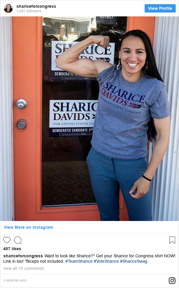 Instagram post by shariceforcongress: Want to look like Sharice?* Get your Sharice for Congress shirt NOW! Link in bio! *Biceps not included.  #TeamSharice #VoteSharice #ShariceSwag