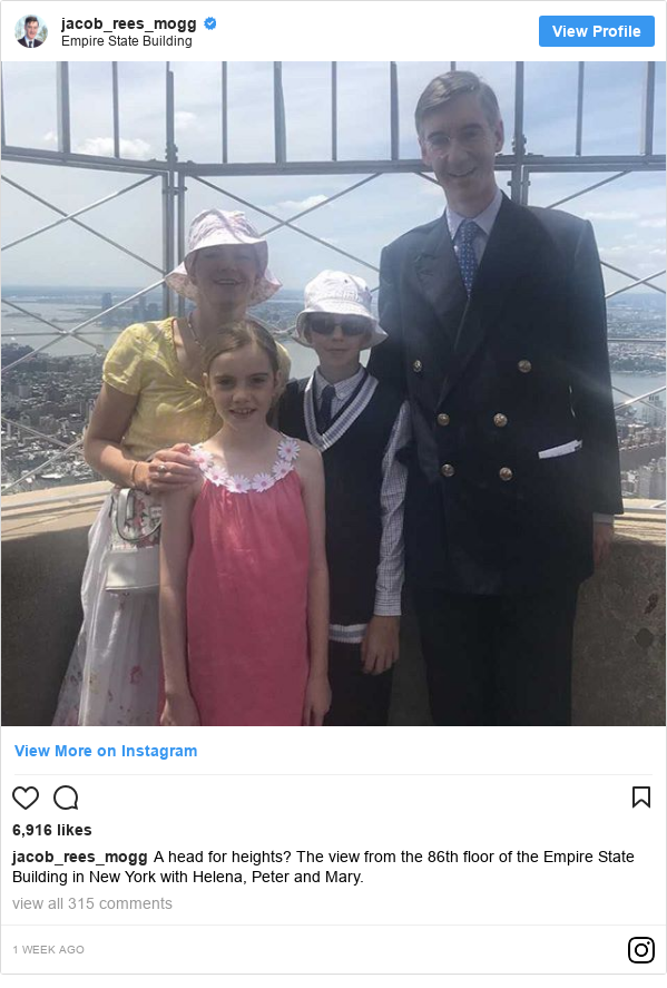 Instagram post by jacob_rees_mogg: A head for heights? The view from the 86th floor of the Empire State Building in New York with Helena, Peter and Mary.