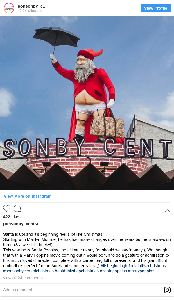 Instagram допис, автор: ponsonby_central: Santa is up! and it's beginning feel a lot like Christmas. Starting with Marilyn Monroe, he has had many changes over the years but he is always on trend (& a wee bit cheeky!). This year he is Santa Poppins, the ultimate nanny (or should we say 'manny'), We thought that with a Mary Poppins movie coming out it would be fun to do a gesture of admiration to this much-loved character, complete with a carpet bag full of presents, and his giant Blunt umbrella is perfect for the Auckland summer rains. ;) #itsbeginningtofeelalotlikechristmas #ponsonbycentralchristmas #eatdrinkshopchristmas #santapoppins #marypoppins
