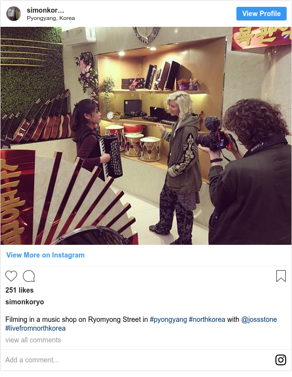 Instagram post by simonkoryo: Filming in a music shop on Ryomyong Street in #pyongyang #northkorea with @jossstone #livefromnorthkorea