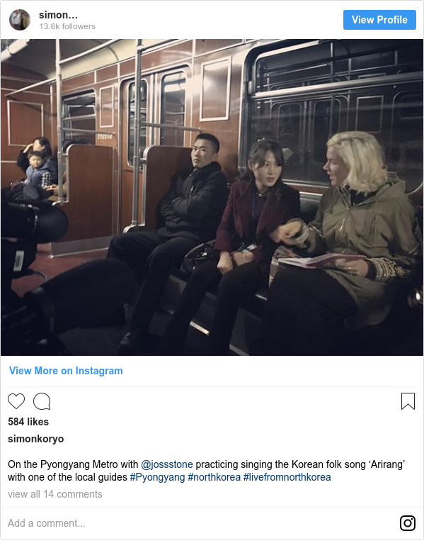 Instagram post by simonkoryo: On the Pyongyang Metro with @jossstone practicing singing the Korean folk song 'Arirang' with one of the local guides #Pyongyang #northkorea #livefromnorthkorea