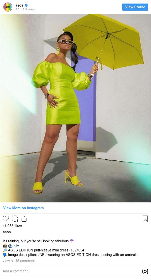 Instagram post by asos: It's raining, but you're still looking fabulous ☔ 📸 @jnelv 🔎 ASOS EDITION puff-sleeve mini dress (1397034) 🗣 Image description  ️JNEL wearing an ASOS EDITION dress posing with an umbrella