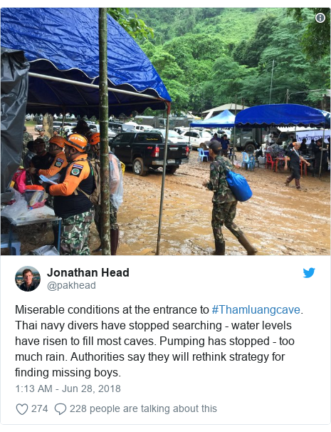 Twitter post by @pakhead: Miserable conditions at the entrance to #Thamluangcave. Thai navy divers have stopped searching - water levels have risen to fill most caves. Pumping has stopped - too much rain. Authorities say they will rethink strategy for finding missing boys.
