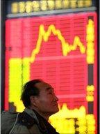 Chinese investor monitors stock exchange data
