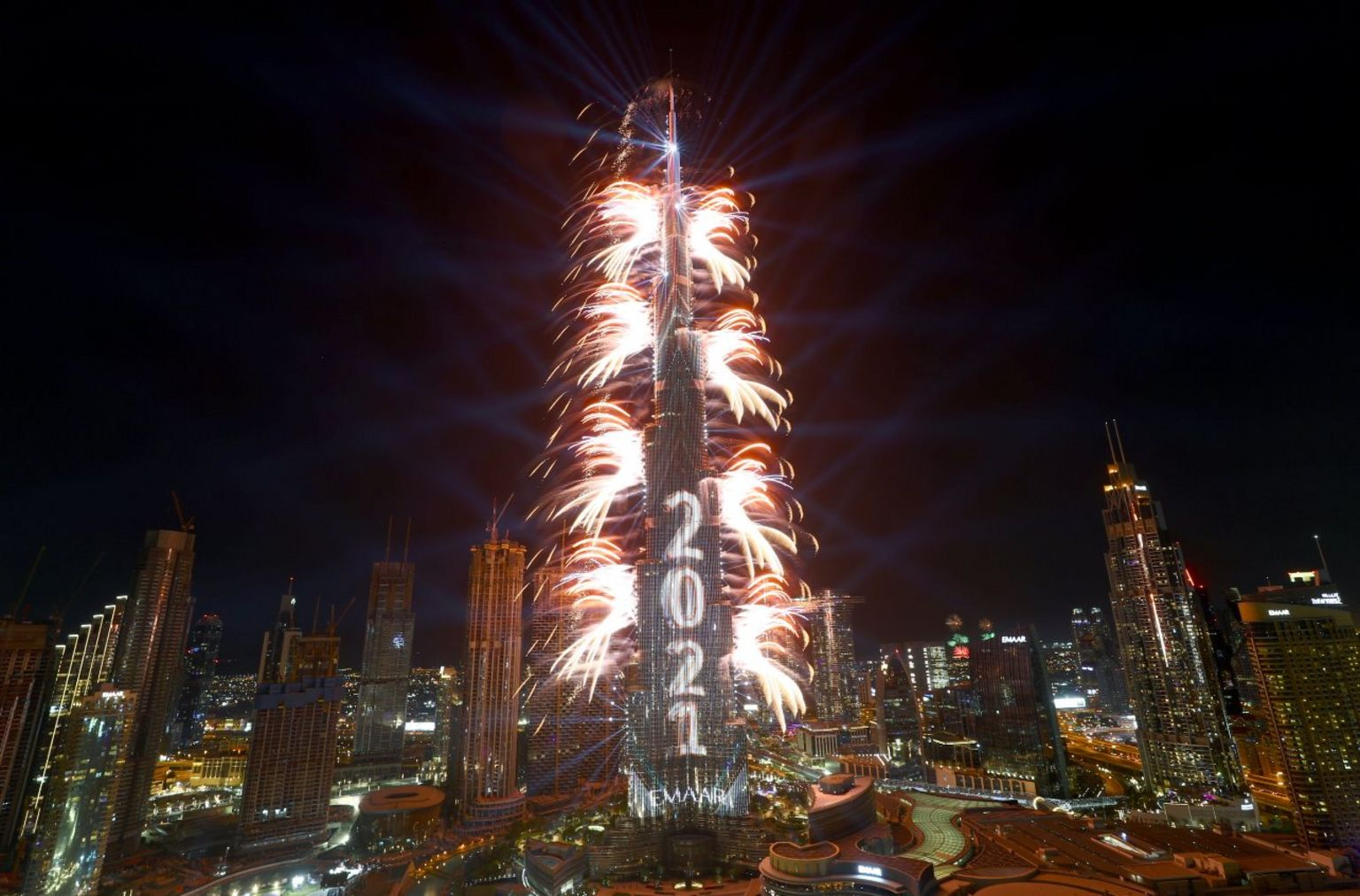 """Fireworks explode from the Burj Khalifa, the tallest building in the world, during New Year""""s Eve celebrations in Dubai"""