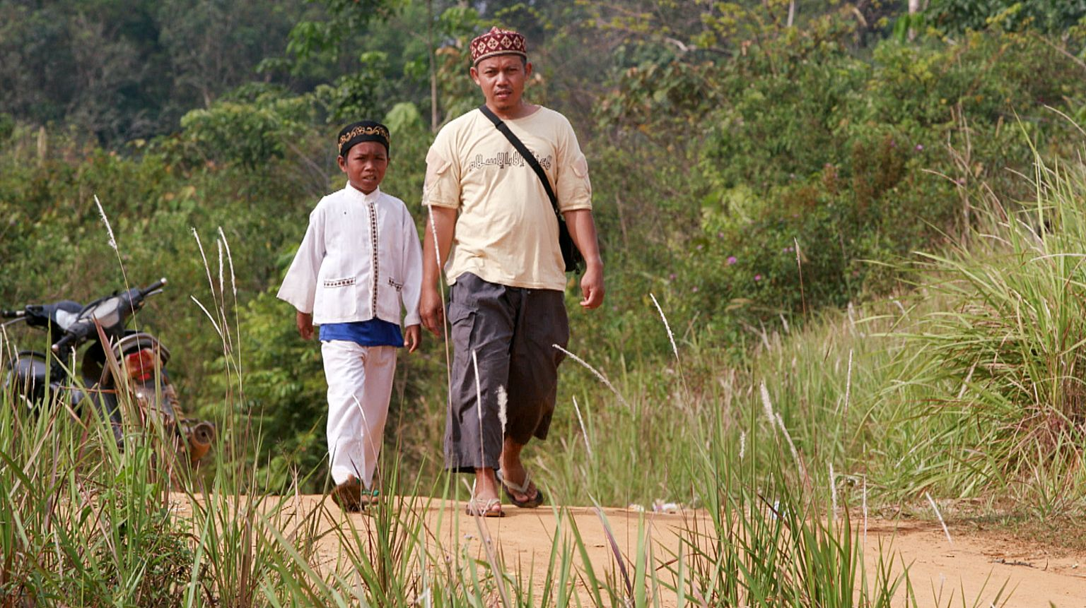 Missionary Ustad Reyhan (right) with a young Muslim boy