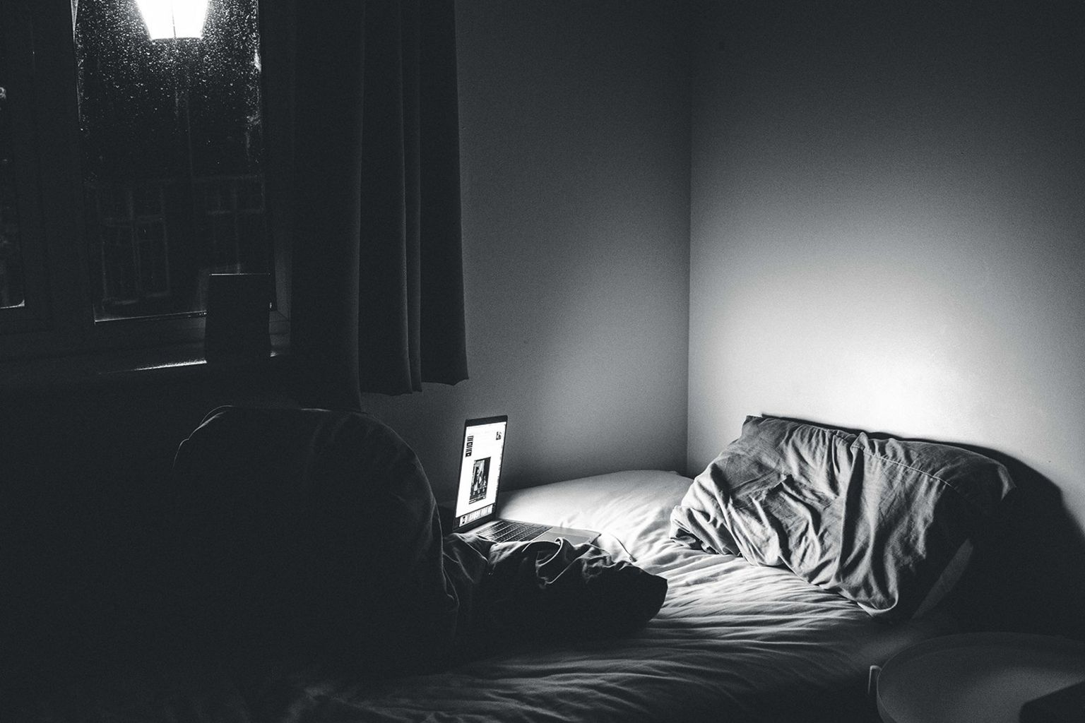 Bed with laptop